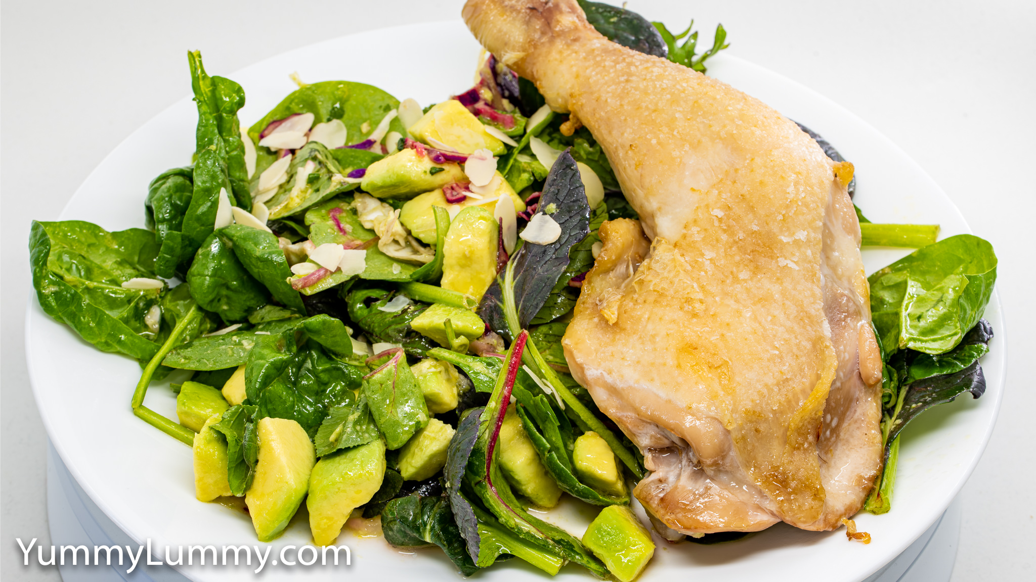 Photograph of Roast chicken and avocado salad. Gary Lum
