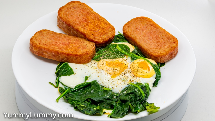 Photograph of Baked spam with steamed eggs and wilted spinach. Gary Lum.