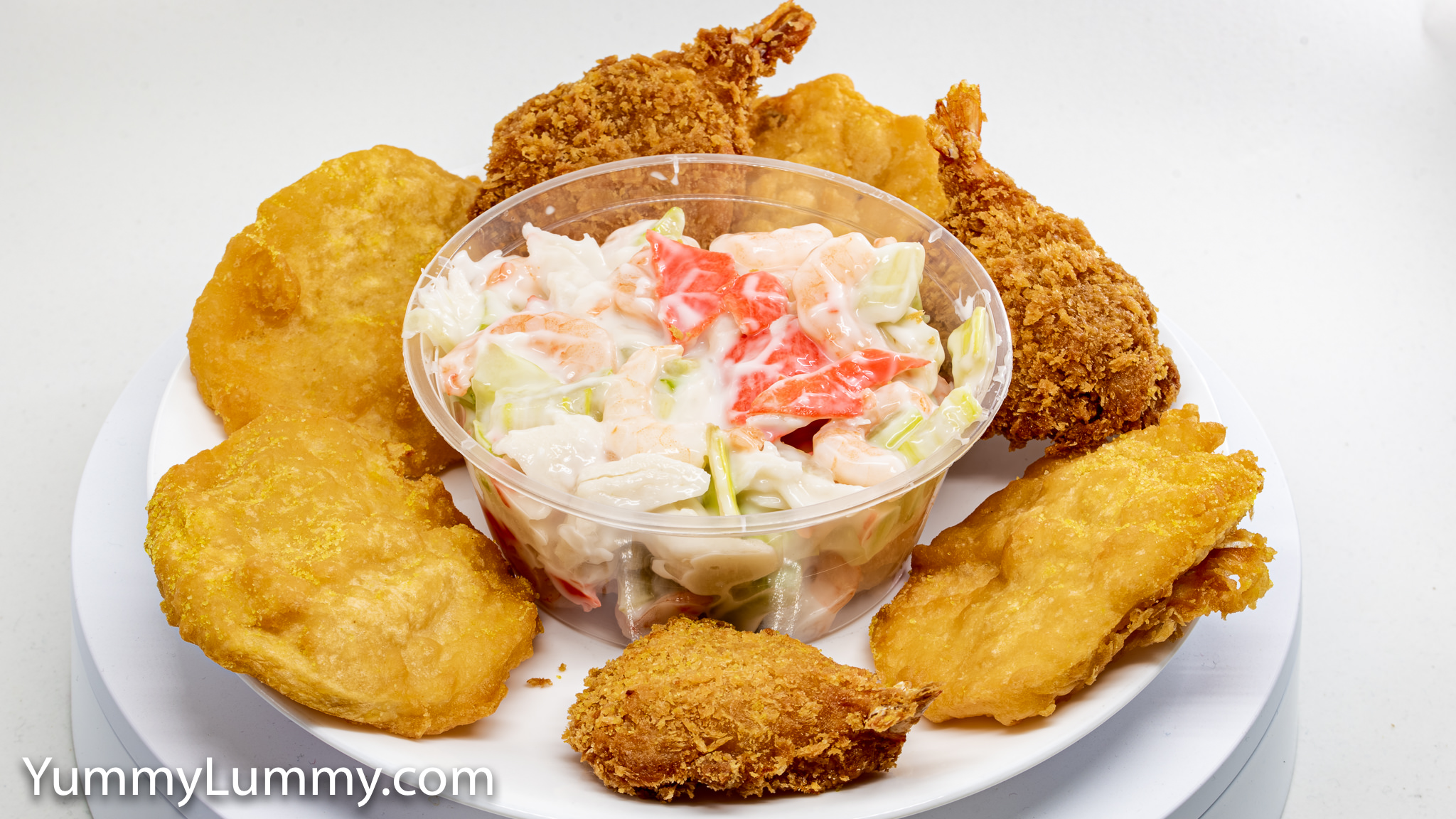 Photograph of Potato scallops Prawn cutlets Seafood salad. Gary Lum.