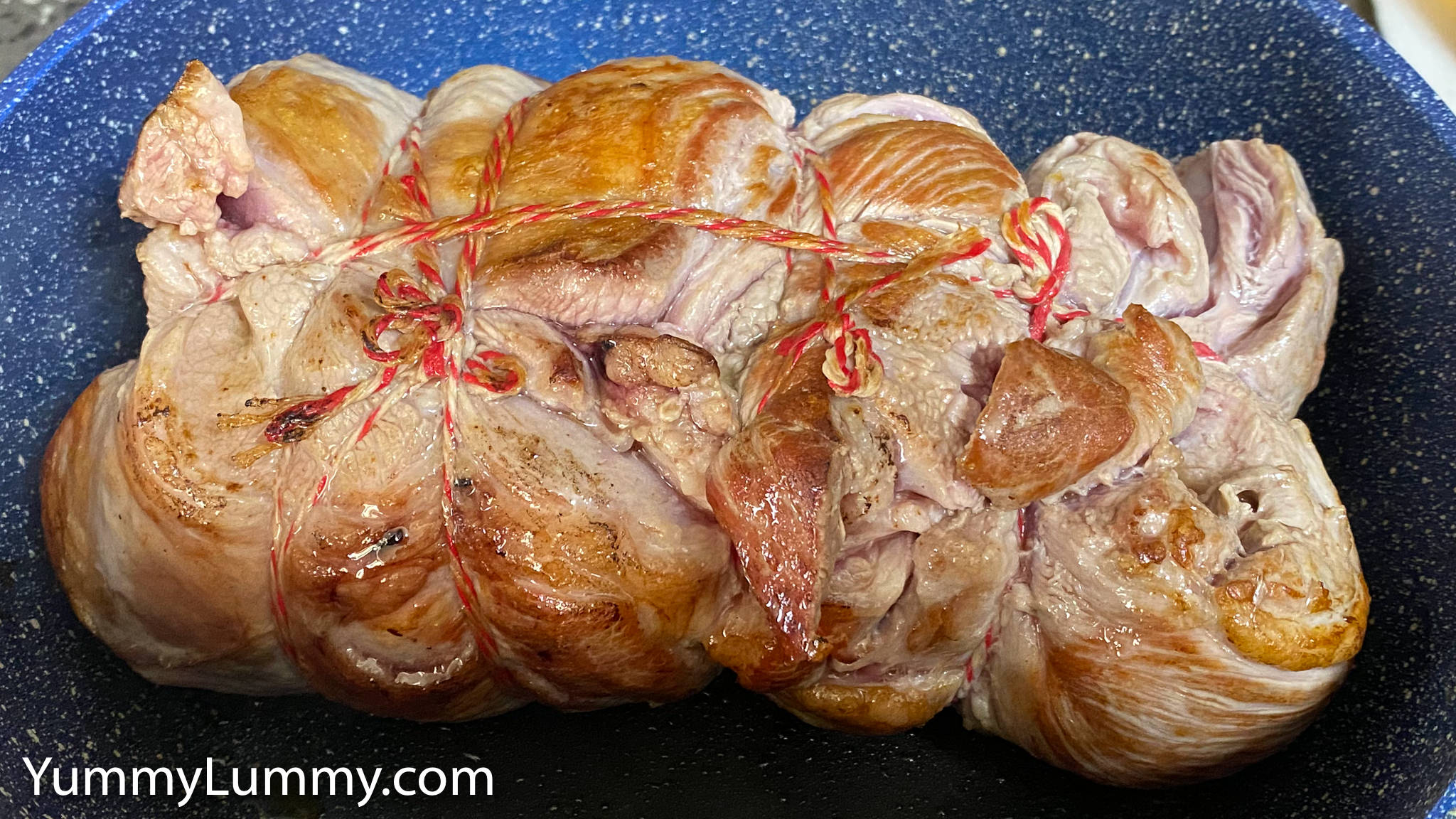 Photograph of searing rolled lamb shoulder. Gary Lum.
