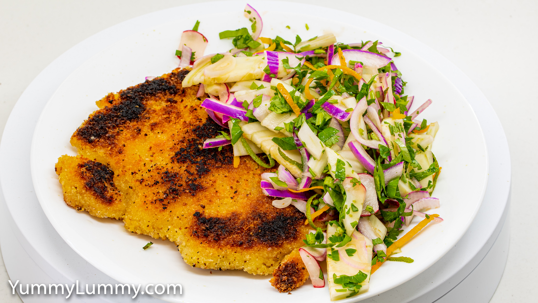 Chicken thigh schnitzel with pickled fennel, red onion, and radish with chopped parsley.. Gary Lum.