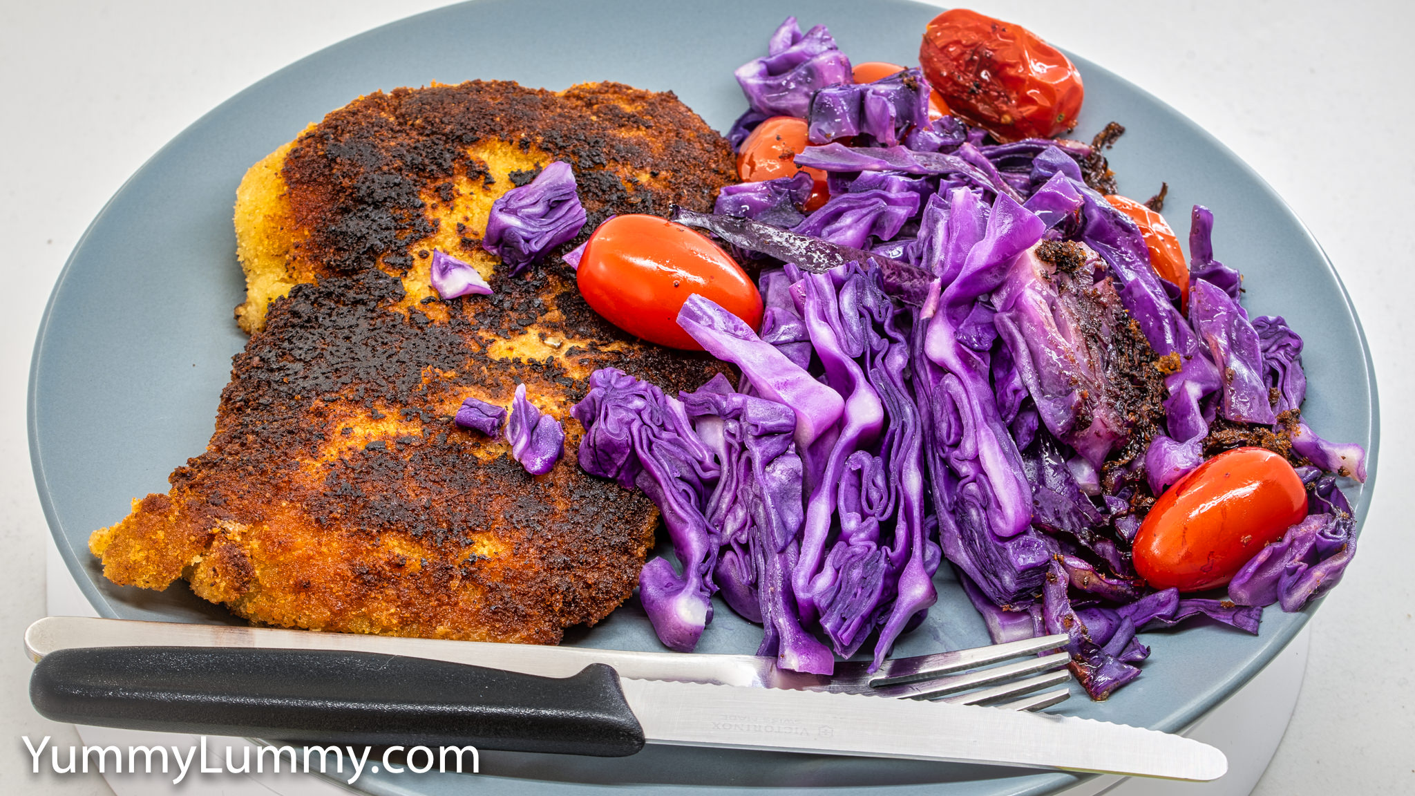 Chicken thigh schnitzel, steamed red cabbage, and steamed cherry tomatoes. Gary Lum.
