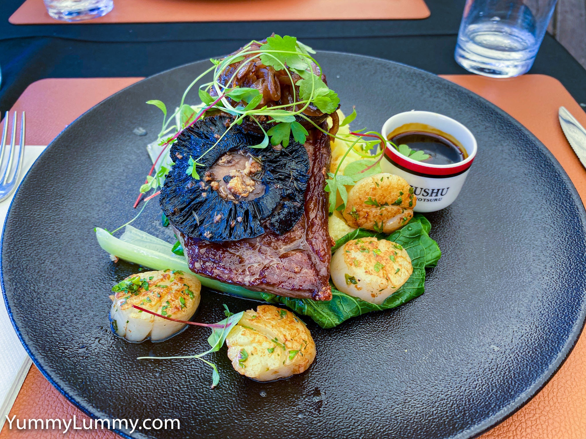 Medium rare Wagyu sirloin with sea scallops, mushroom, caramelised onions, potato mash, jus, and bok choi. Gary Lum.