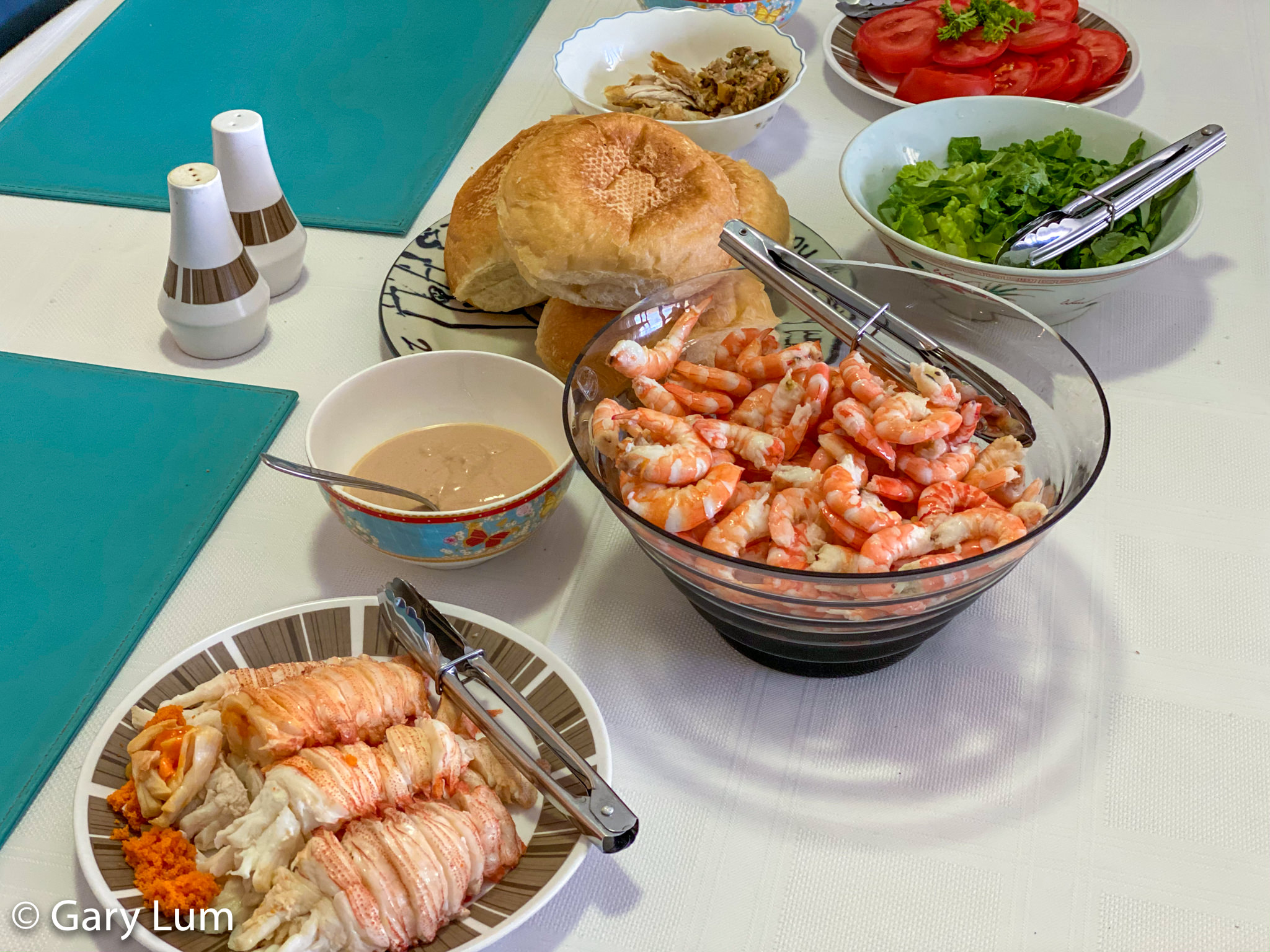 New Year's Day 2020 lunch. Moreton Bay Bugs and Endeavour prawns with fresh white bread rolls. Gary Lum.