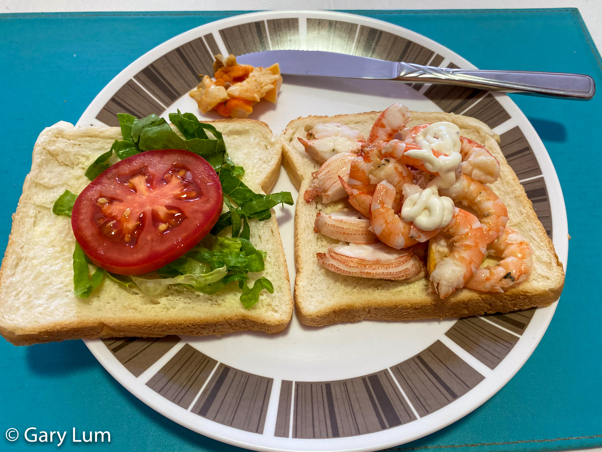 New Year's Day 2020 lunch. Moreton Bay Bugs and Endeavour prawns with fresh white bread plus cos lettuce and roma tomato. Gary Lum.