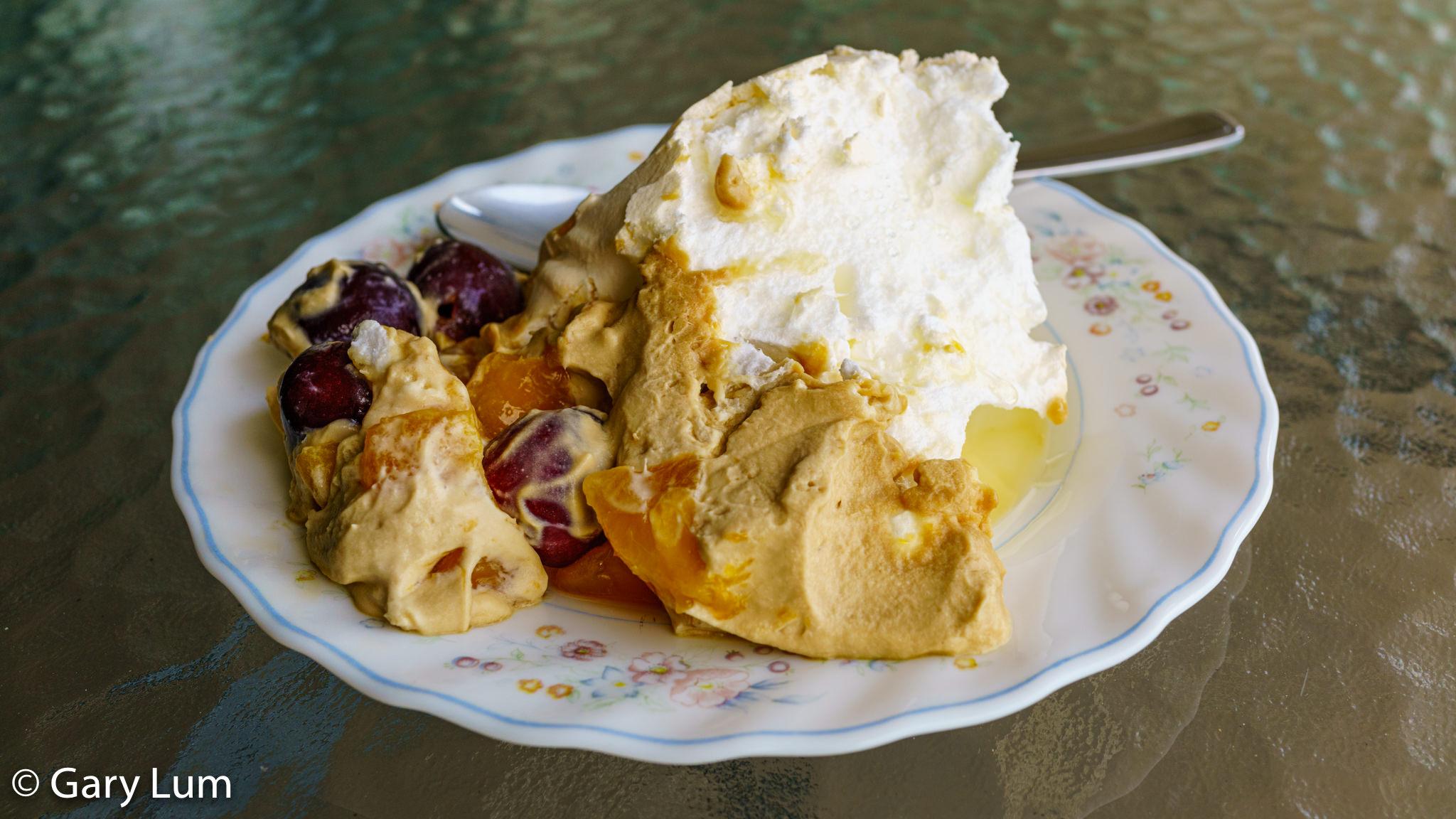 Breakfast of champions. Pavlova with brown sugar cream, cherries, and mango. Gary Lum.