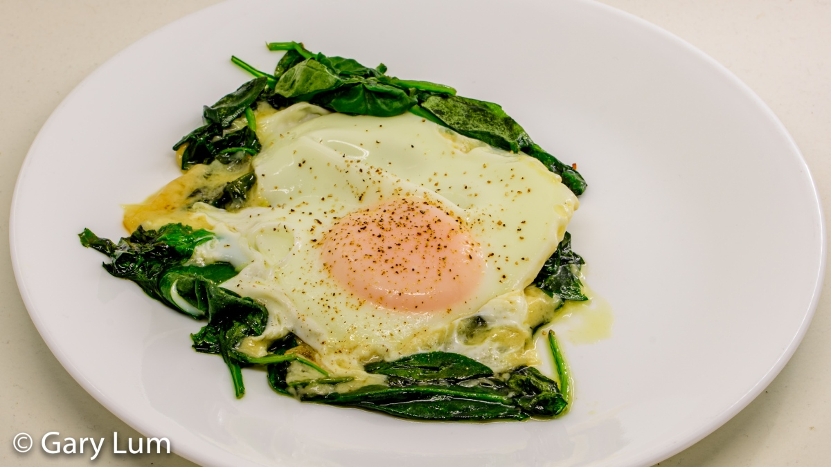 Steamed egg, melted cheese, and wilted spinach leaves