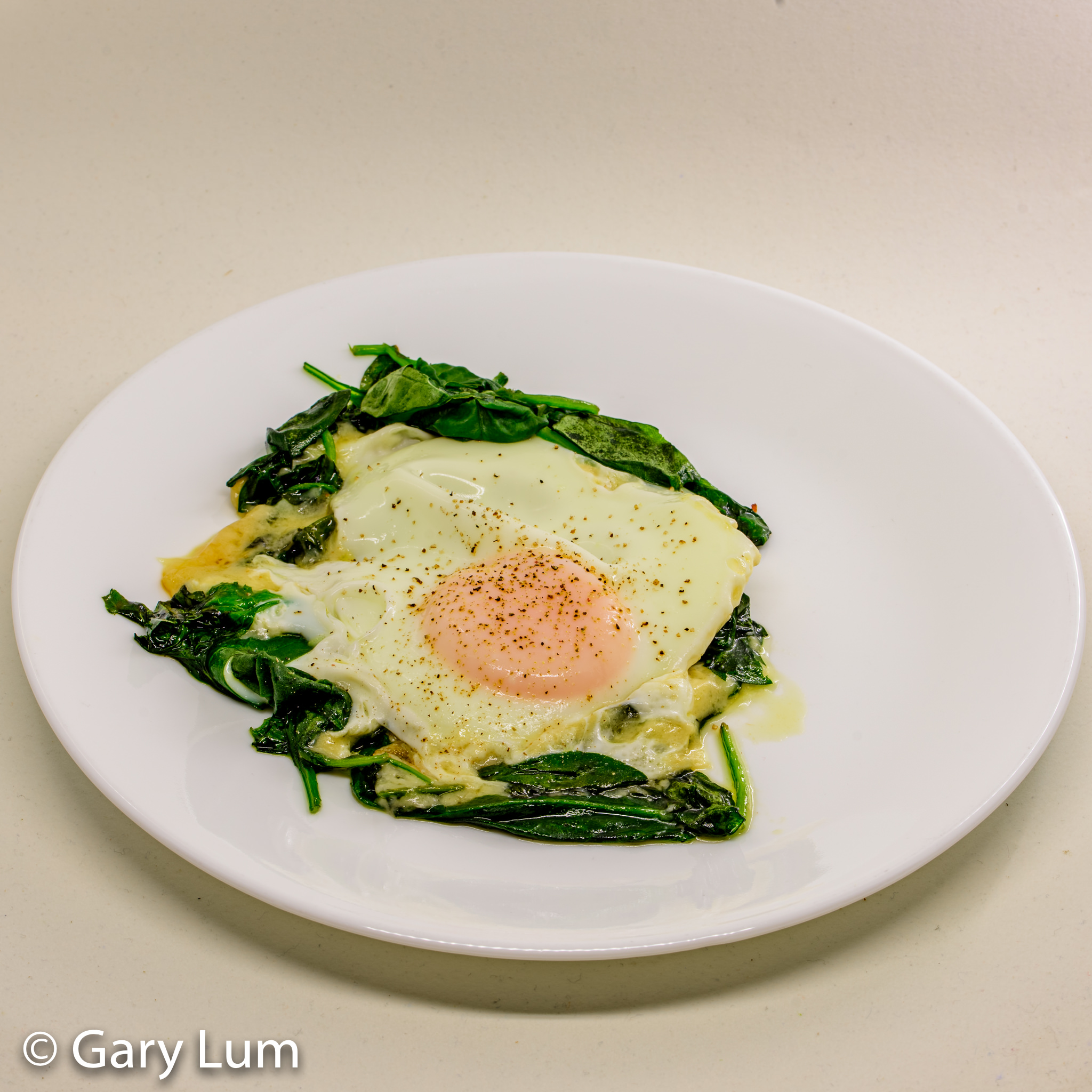 Steamed egg, melted cheese, and wilted spinach leaves. Gary Lum.