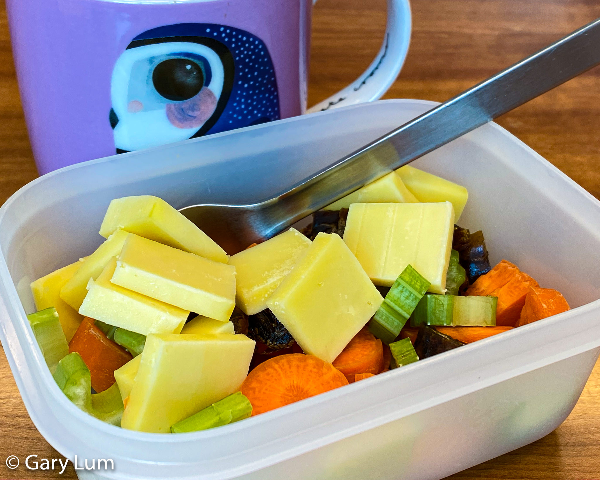 Carrot, celery, cheese, and dates for lunch with a cup of tea. Gary Lum.