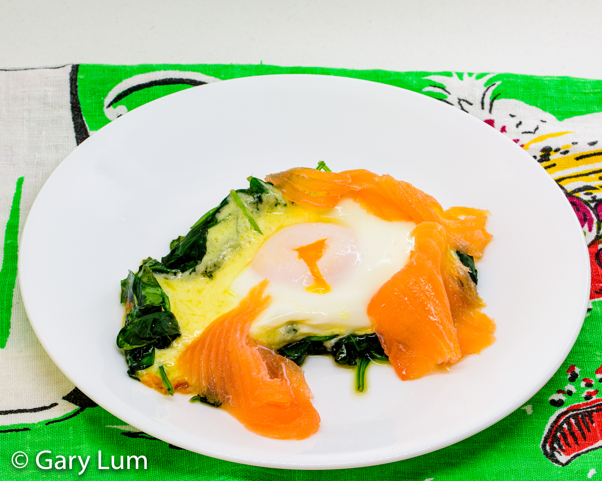 Steamed egg, melted cheese, wilted spinach, and smoked salmon. Gary Lum.