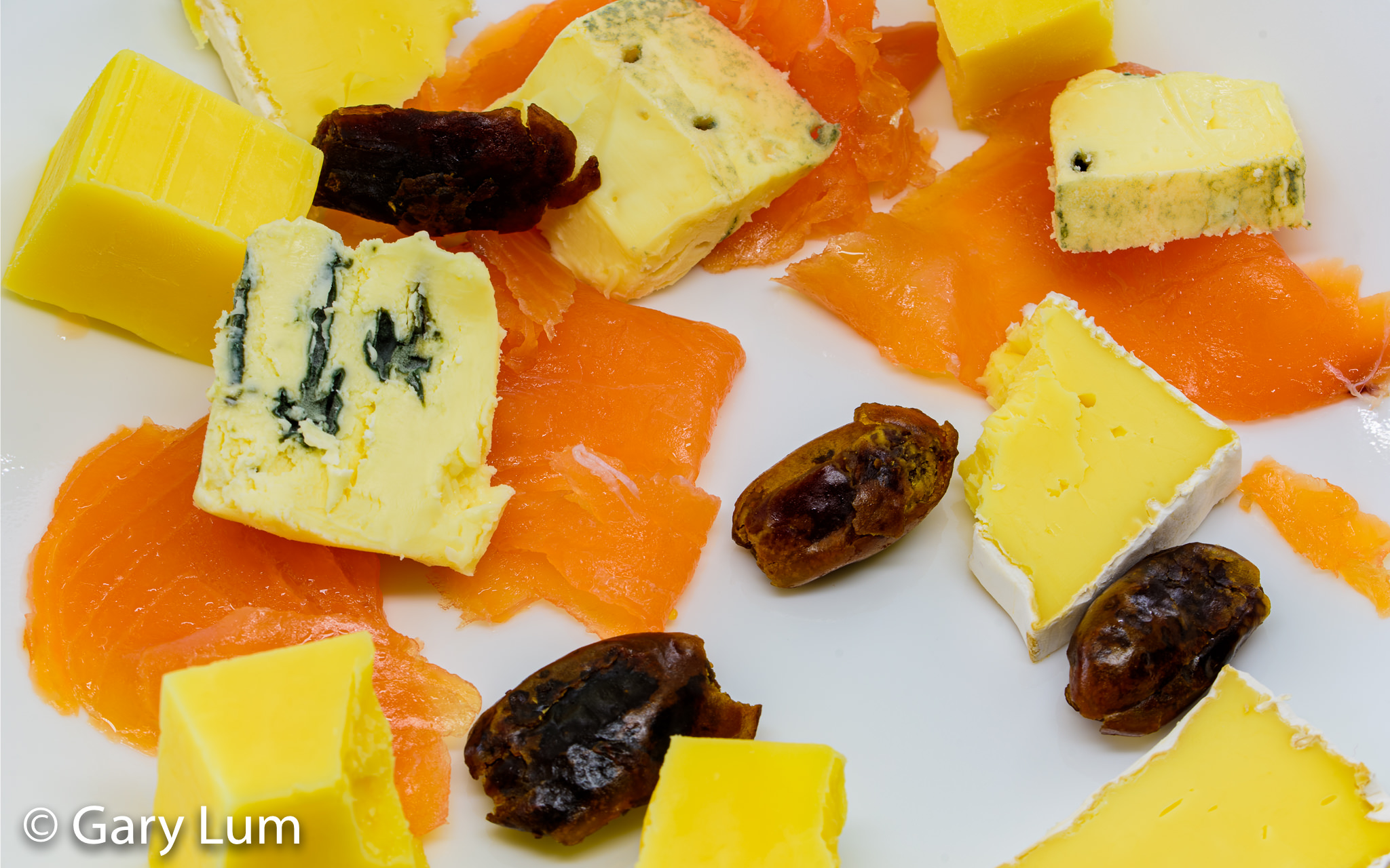 Smoked salmon with Coon™ cheese, Brie, Blue cheese, and Dates. Gary Lum.