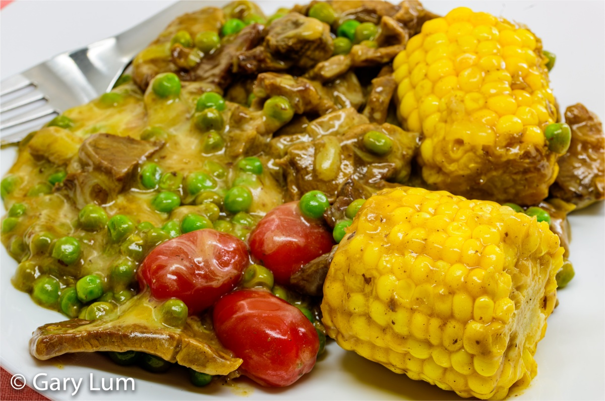 Leftover lamb with corn and peas in cheese gravy