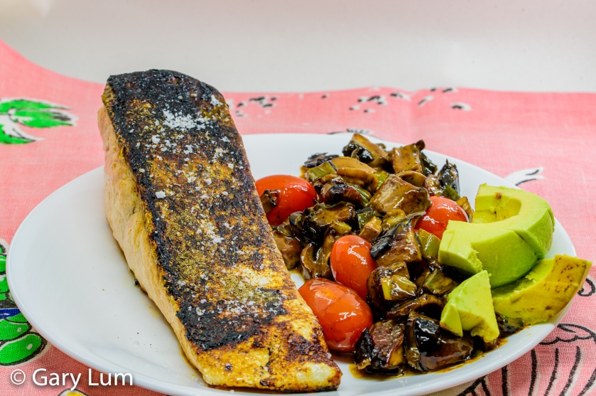 Pan-fried salmon with creamy mushrooms and avocado. Gary Lum.