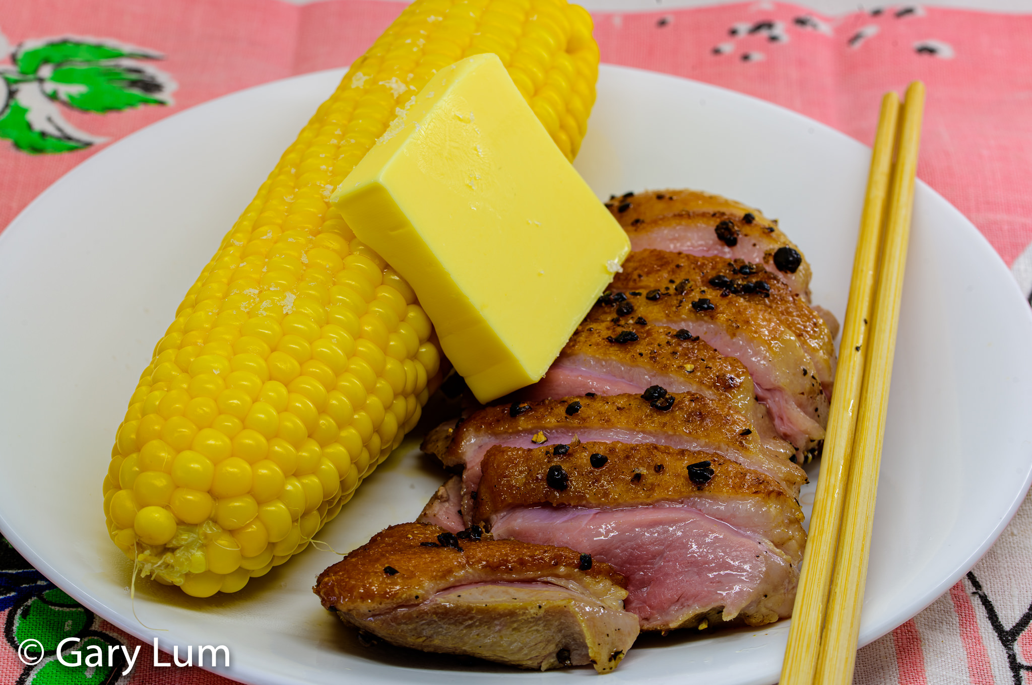 Butter served with sous vide duck breast and a corn cob. Gary Lum.