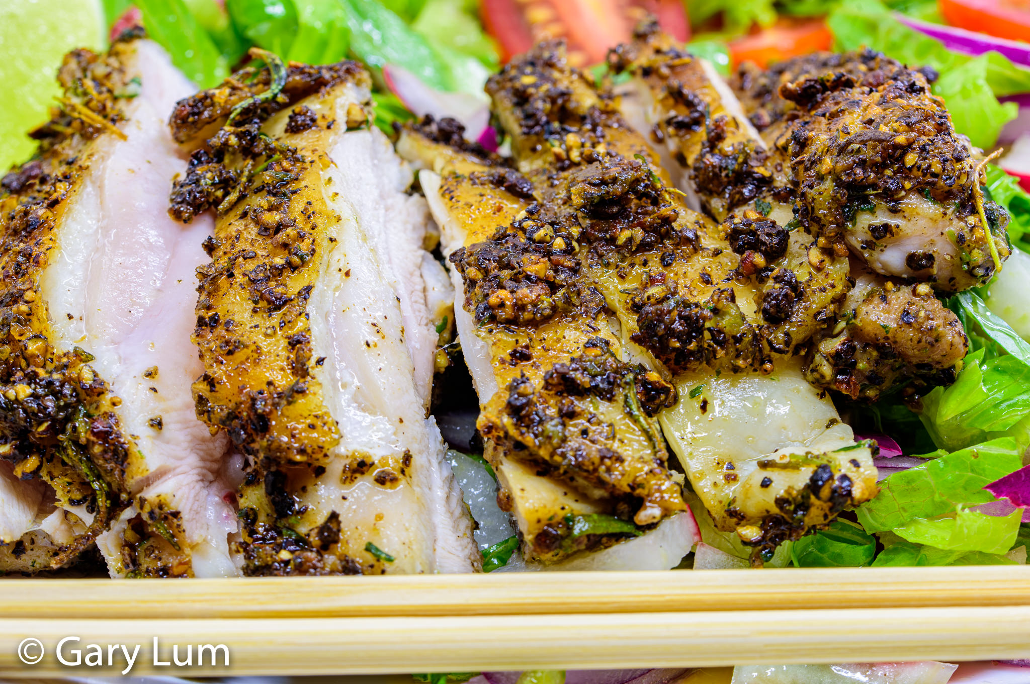 Close up. Pan-fried deboned chicken thigh and salad. Gary Lum.