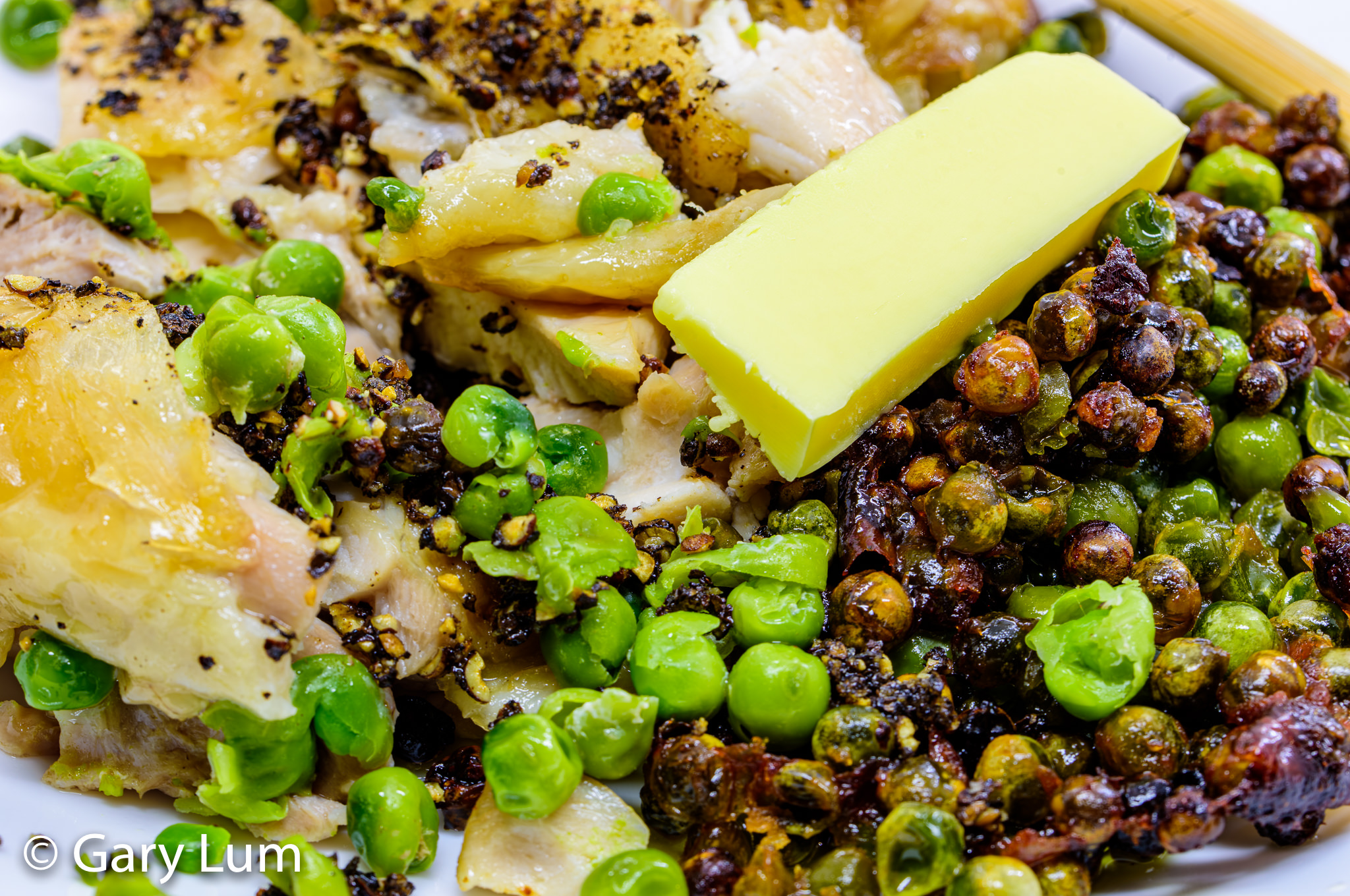 Close up. Oven-baked deboned chicken thigh and crispy green peas. Gary Lum.