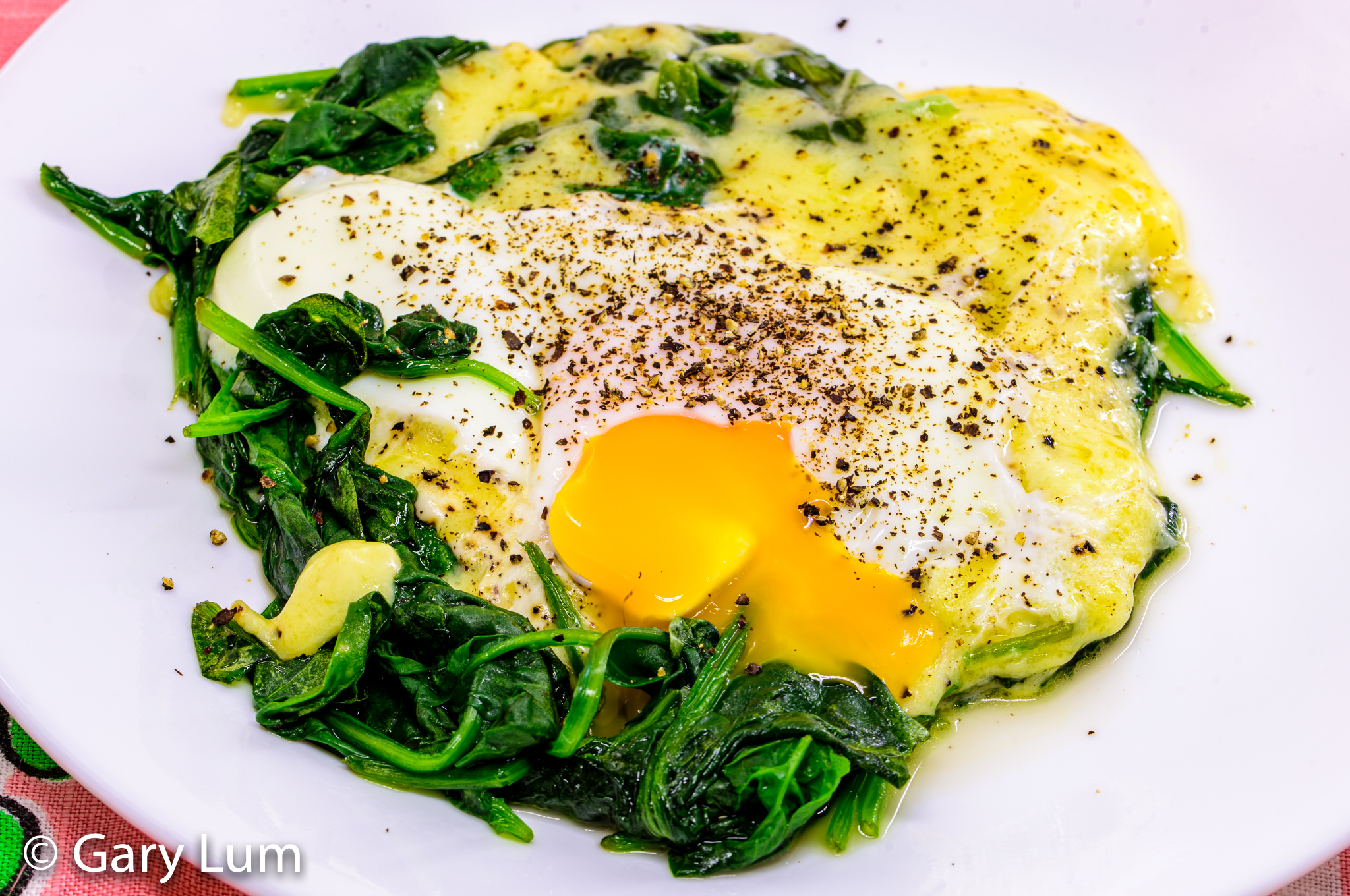 Steamed egg, melted cheese, and wilted spinach. Gary Lum.
