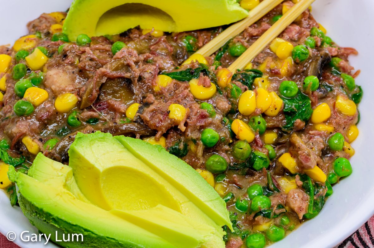 Corned beef with mushrooms, corn, peas, and avocado
