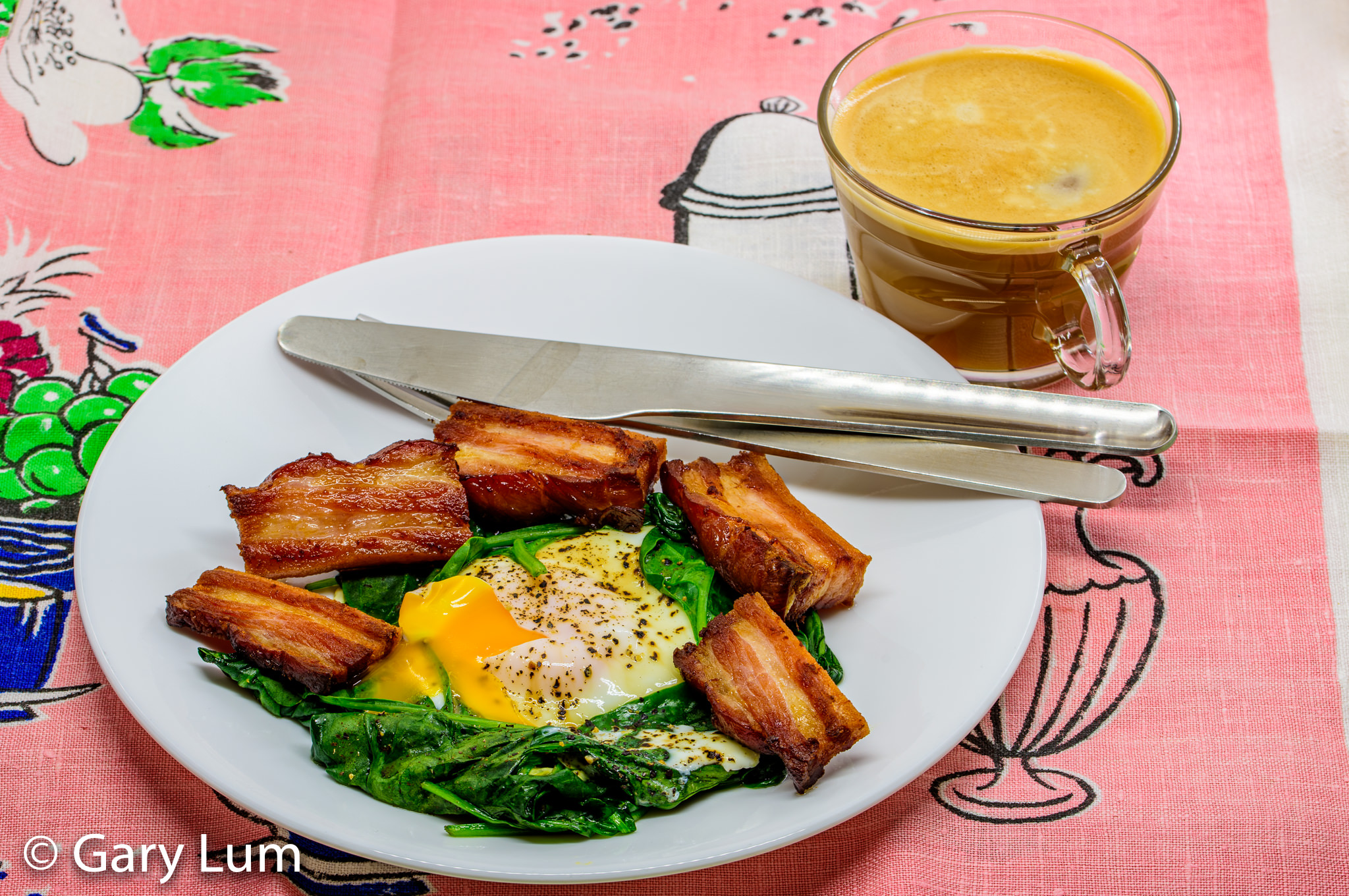 Oven cooked speck with steamed egg and wilted spinach served with Nespresso™ coffee. Gary Lum.