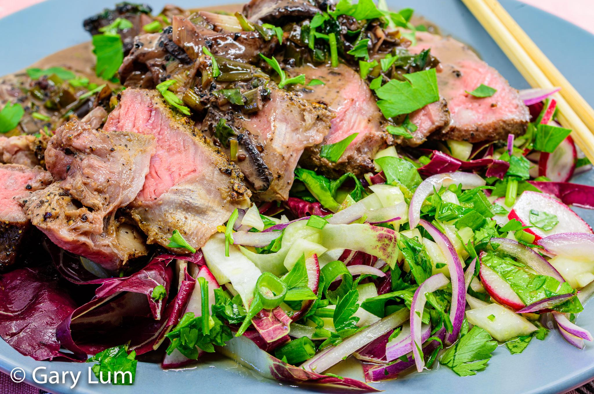 Close up. Porterhouse steak and radicchio salad. Gary Lum.