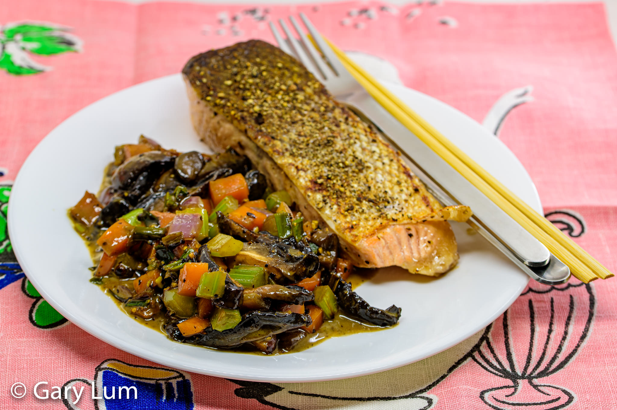 Pan-fried salmon with creamy mushrooms and vegetables. Gary Lum.