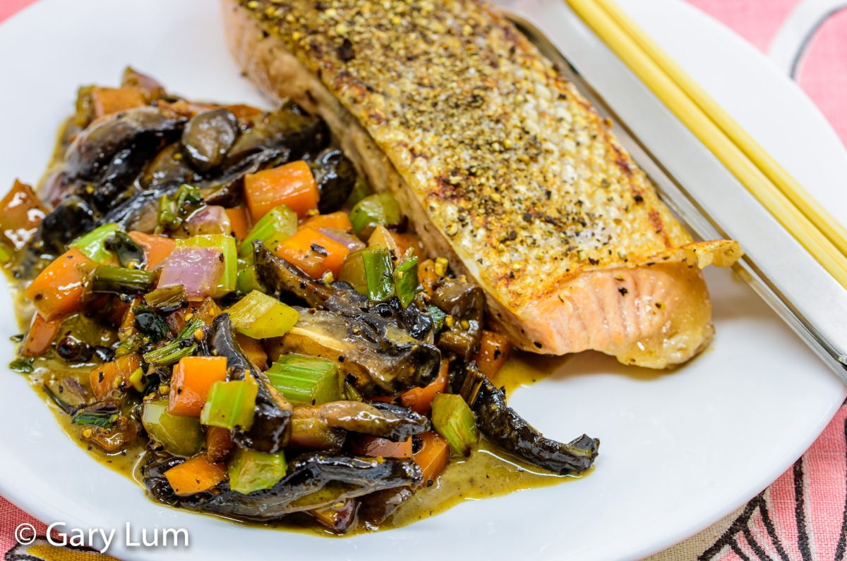 Close up. Pan-fried salmon with creamy mushrooms and vegetables. Gary Lum.