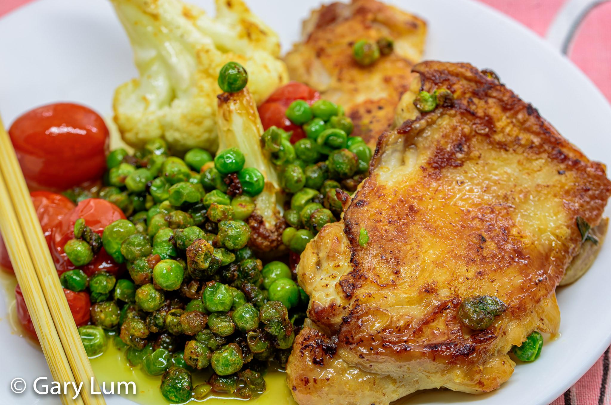 Close up. Pan-fried boneless chicken and vegetables. Gary Lum.