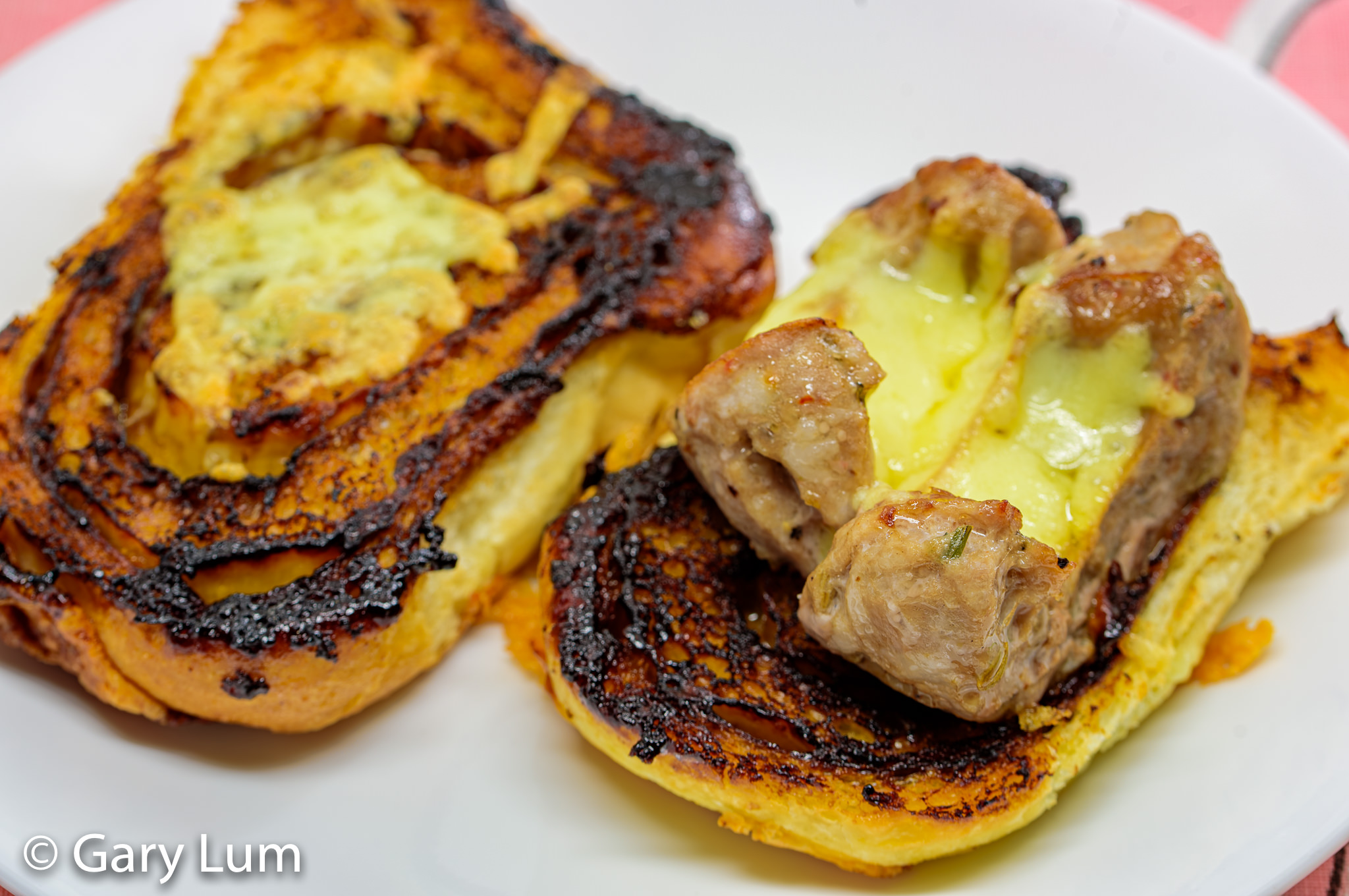 Toasted Vegemite scroll with melted cheese and pork sausage. Because when I have manflu I eat carbs. Gary Lum.