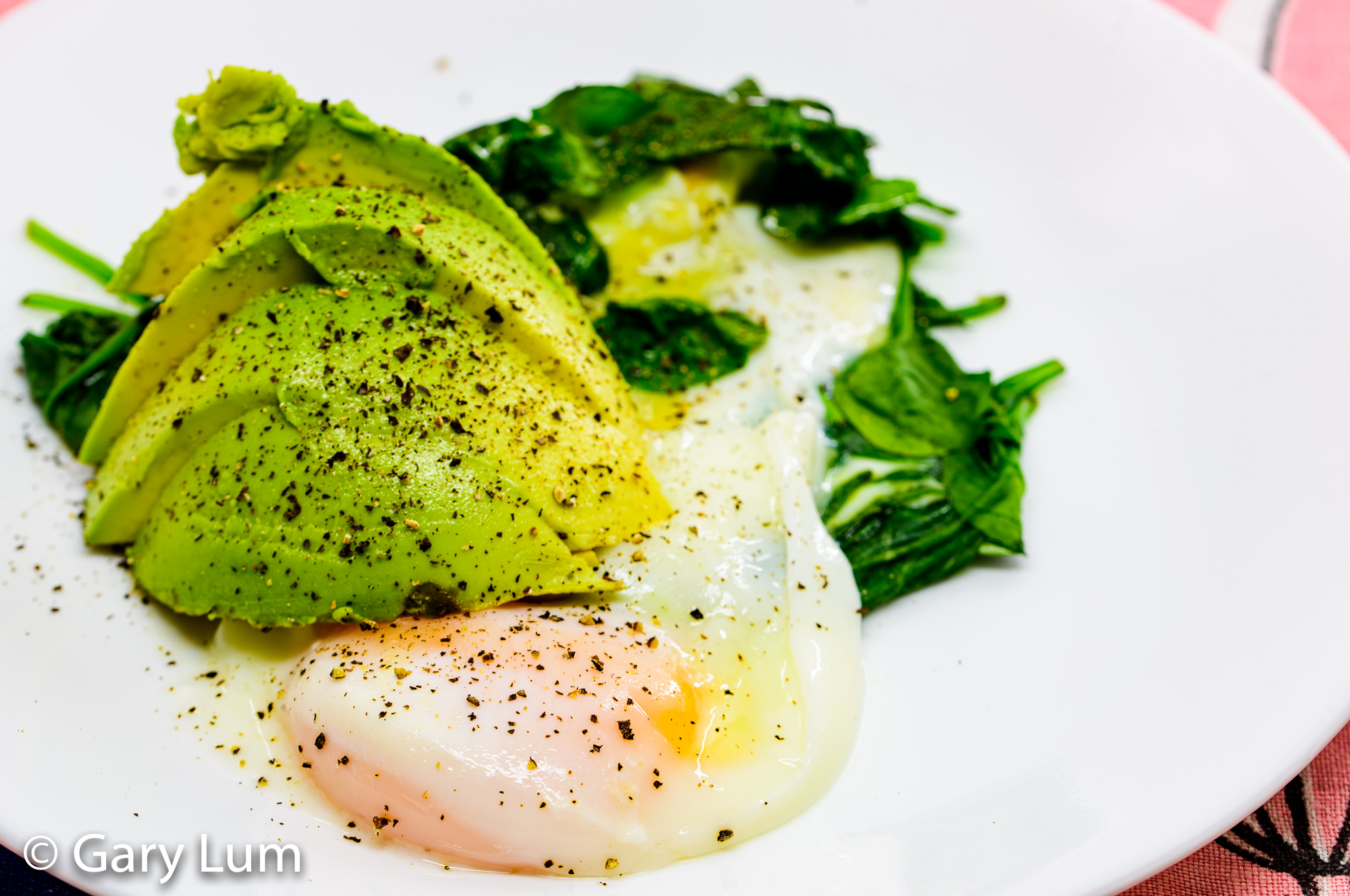Steamed egg with melted cheese and wilted spinach and an avocado cheek. Gary Lum.
