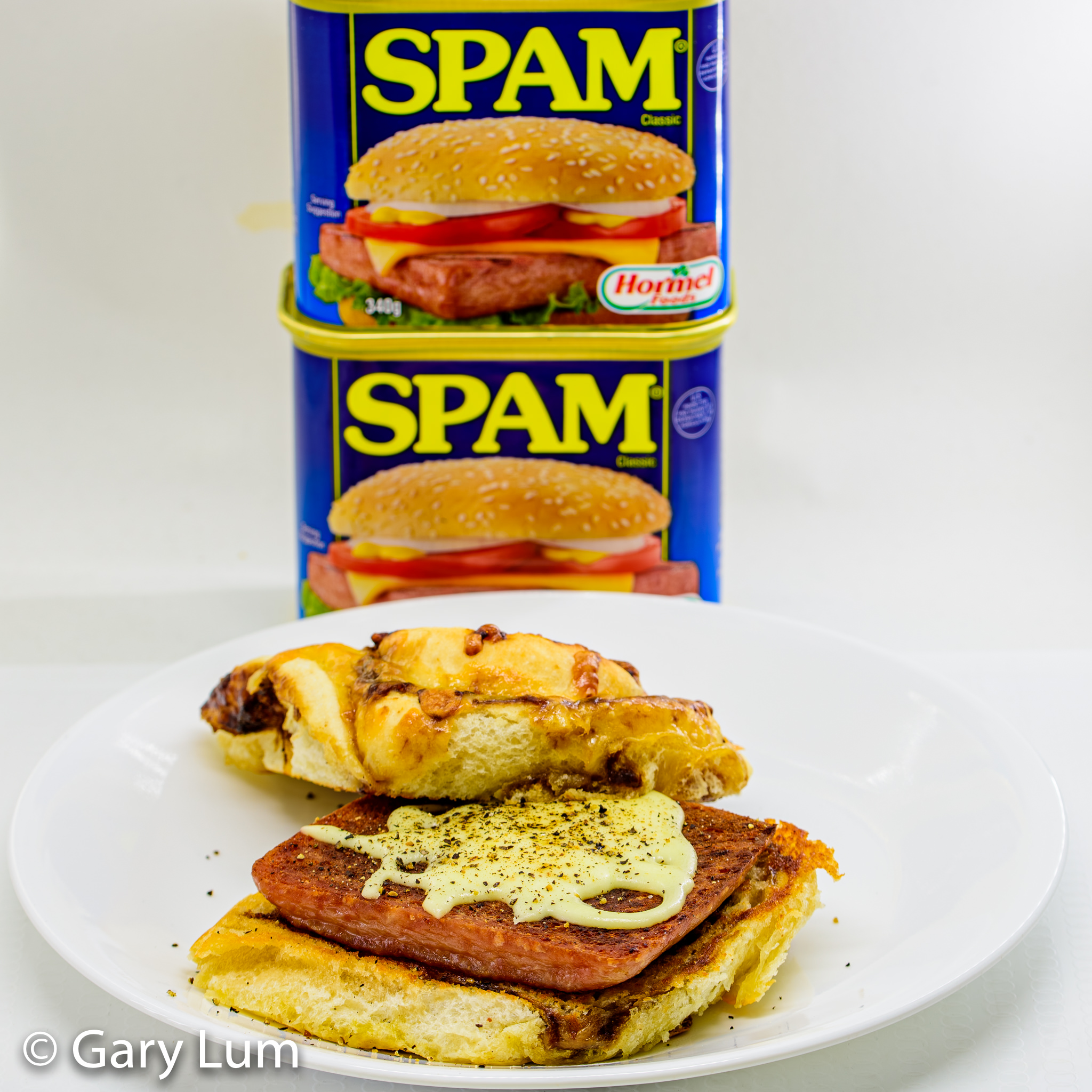 Pan-fried Spam with melted Mozzarella on a Coles Cheesy Vegemite Scroll. Gary Lum.