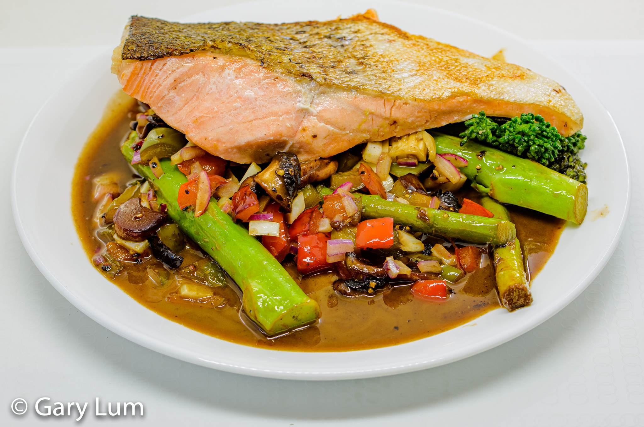 Pan-fried salmon with broccolini, asparagus, capsicum, red onion, fennel, and leftover gravy. Gary Lum.