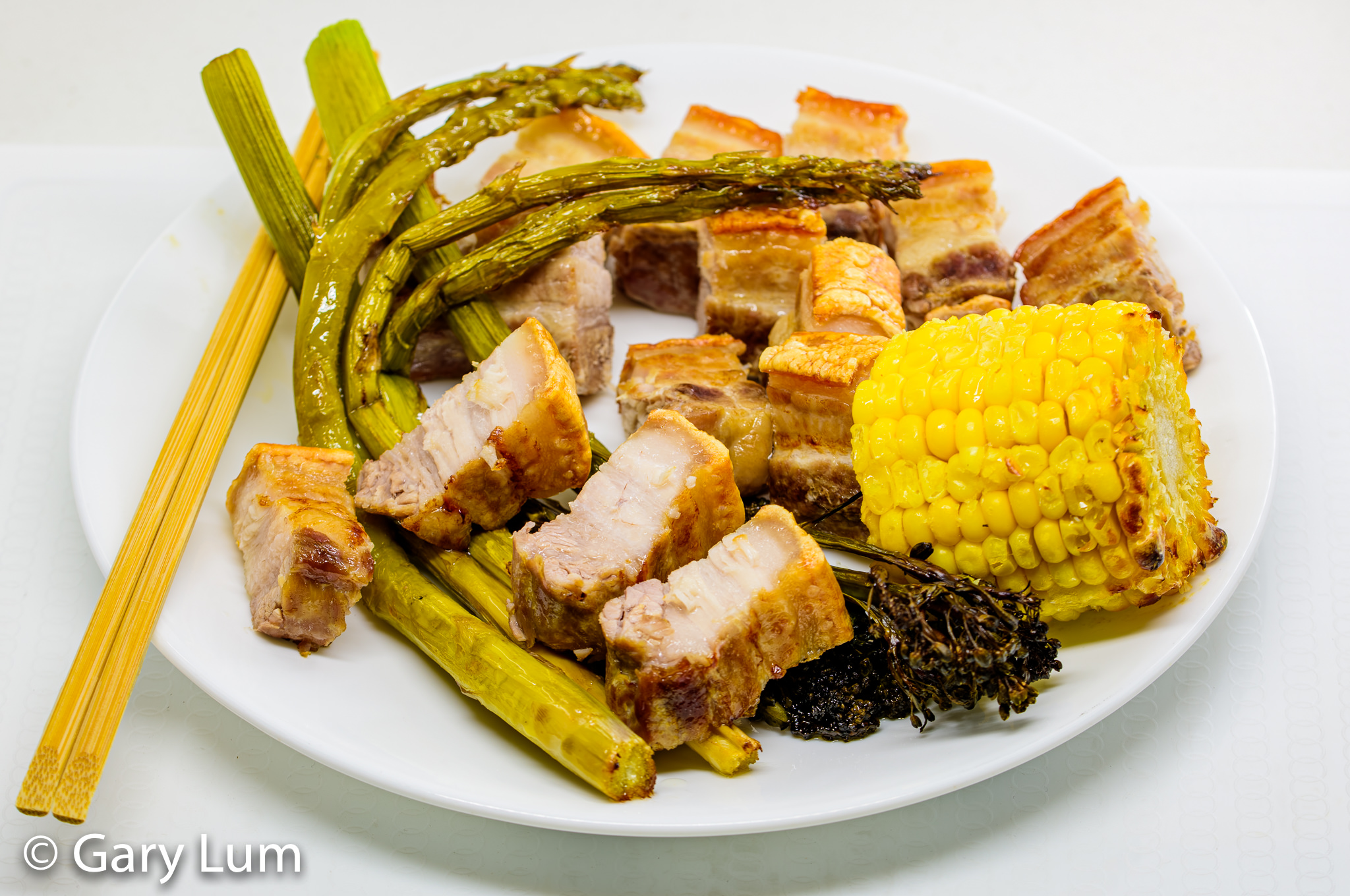 Oven-baked pork belly with broccolini, asparagus, and corn. Gary Lum.