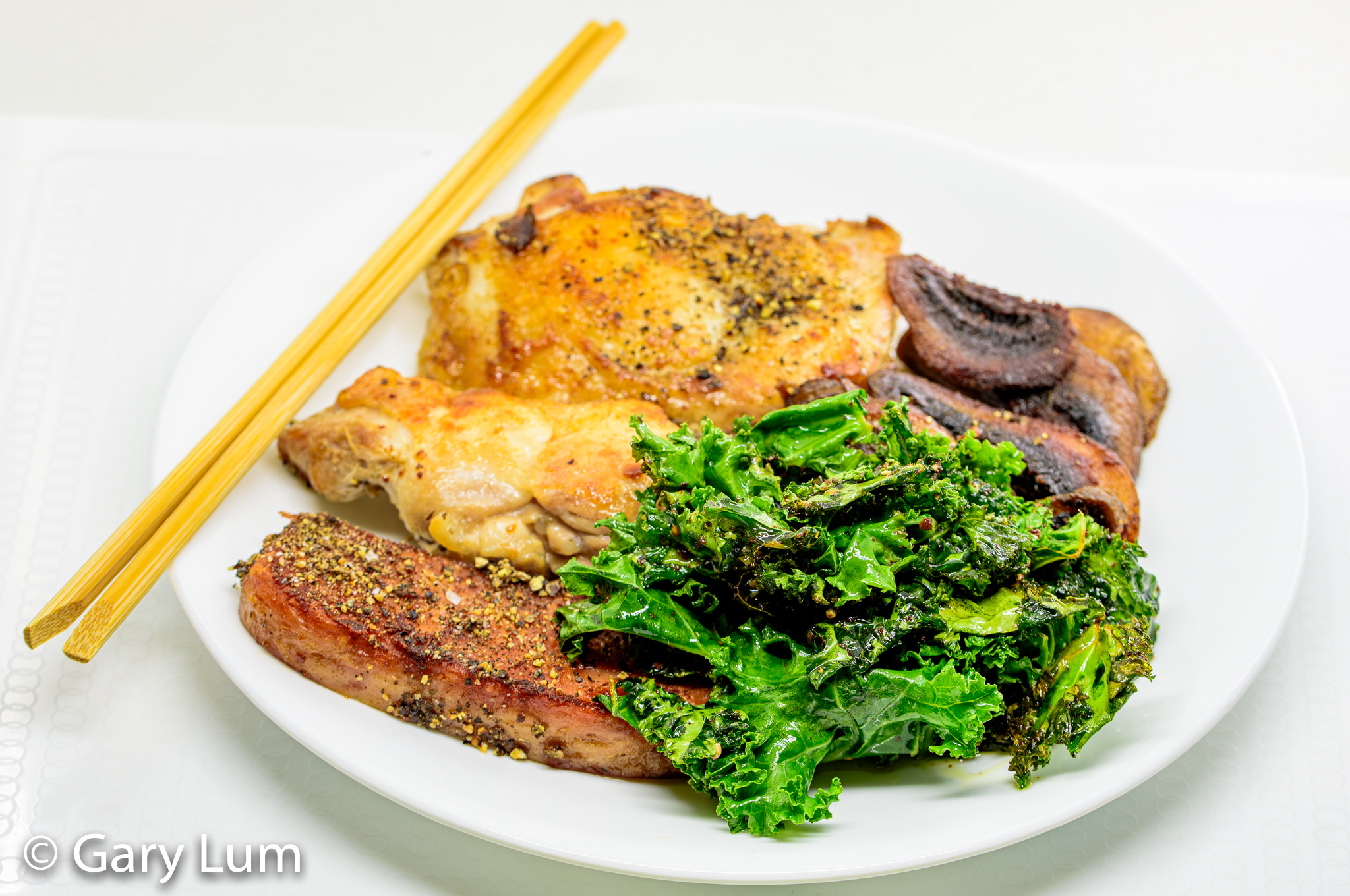 Pan-fried deboned chicken thigh and drumstick with Spam, mushrooms, and kale. Gary Lum.