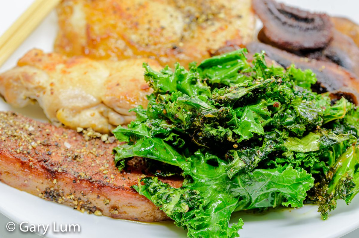Close up. Pan-fried deboned chicken thigh and drumstick with Spam, mushrooms, and kale. Gary Lum.