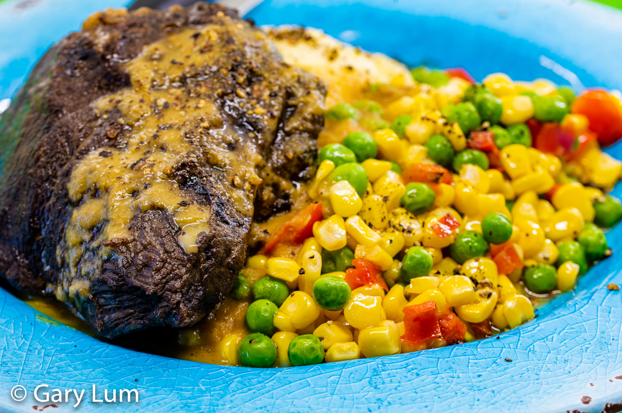 Slow cooker beef cheeks with potato mash and gravy served with peas and corn. Gary Lum.