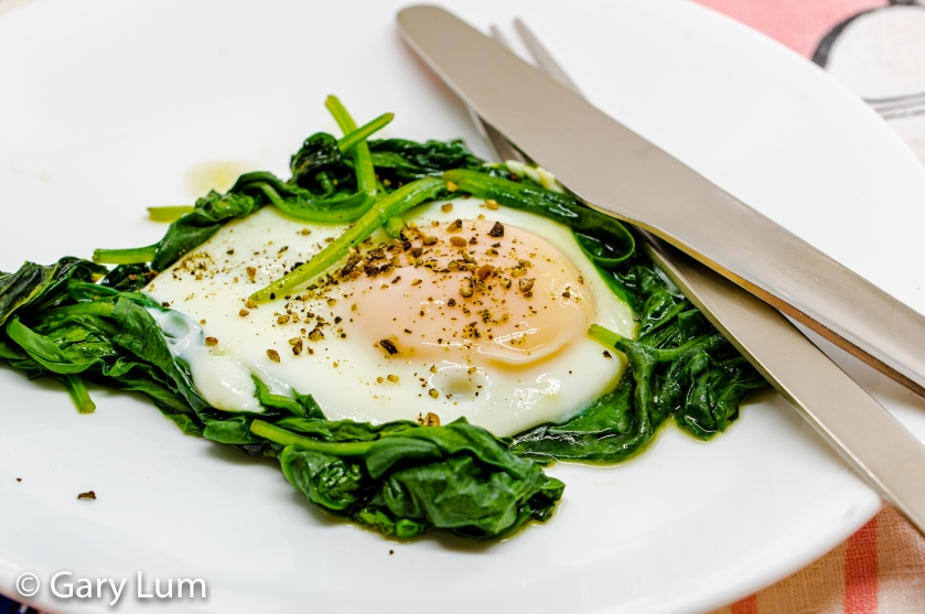 Happy Easter. Steamed egg and wilted spinach.