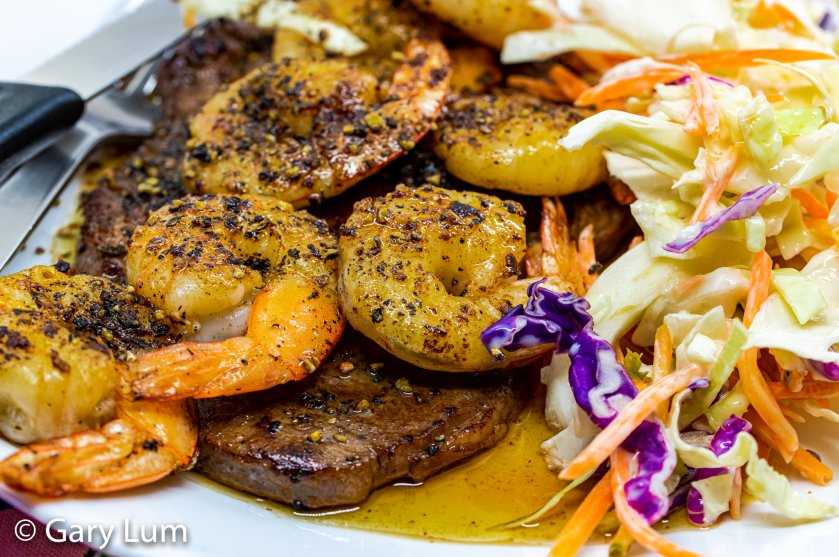 Close up. Pan-fried surf'n'turf. Steak and prawns with coleslaw.