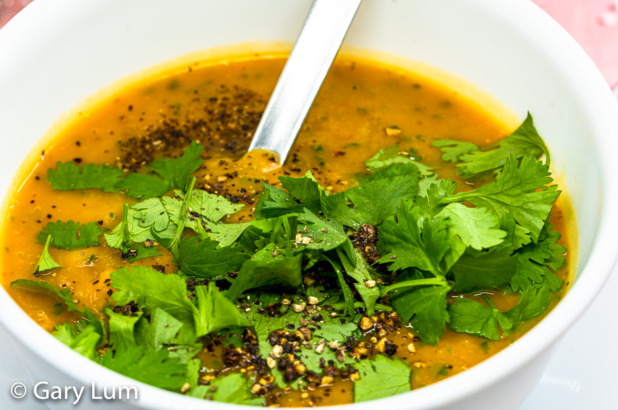 Close up. Spicy Thai curry butternut pumpkin soup with coriander. #covidlife #stayhome #workfromhome