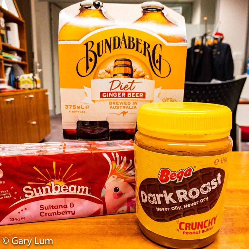 COVID-19 work snacks. Bundaberg ginger beer, sultanas and cranberries, and crunchy dark roasted peanut paste.