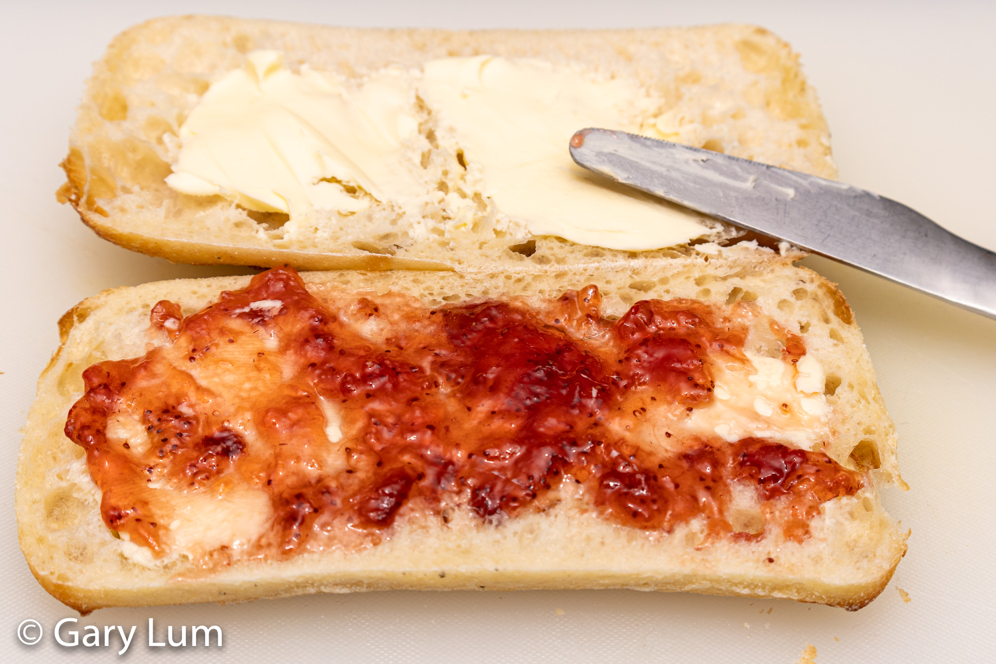 Turkish bread roll with Lurpak butter and jam.