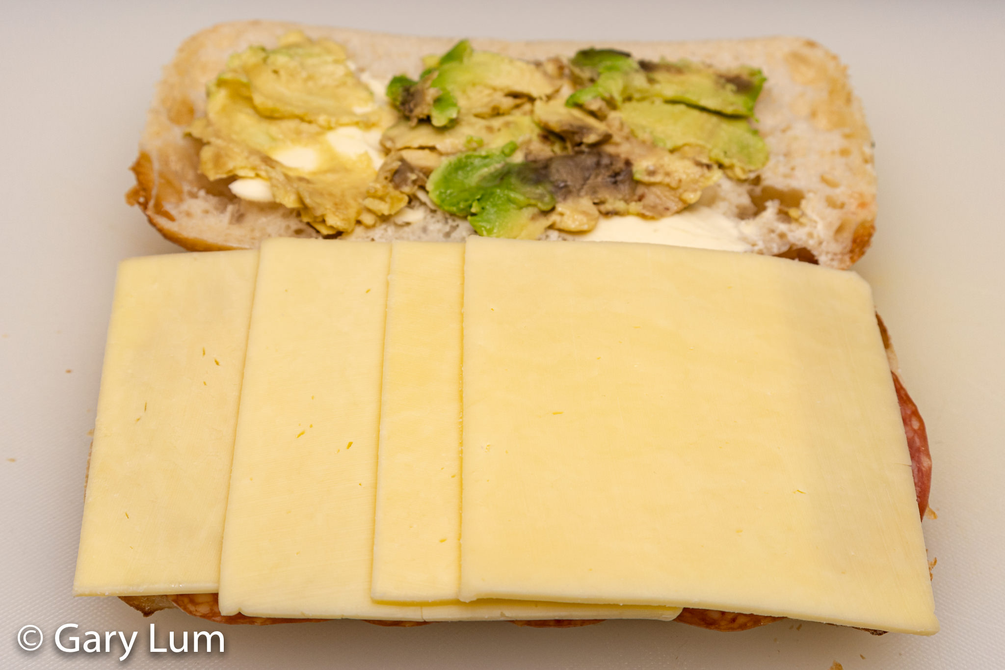 Turkish bread roll with Lurpak butter, jam, salami, Coon™ mozzarella and Colby cheeses and avocado.