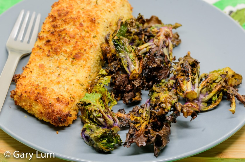 Oven-cooked crumbed salmon and seasoned kale sprouts.