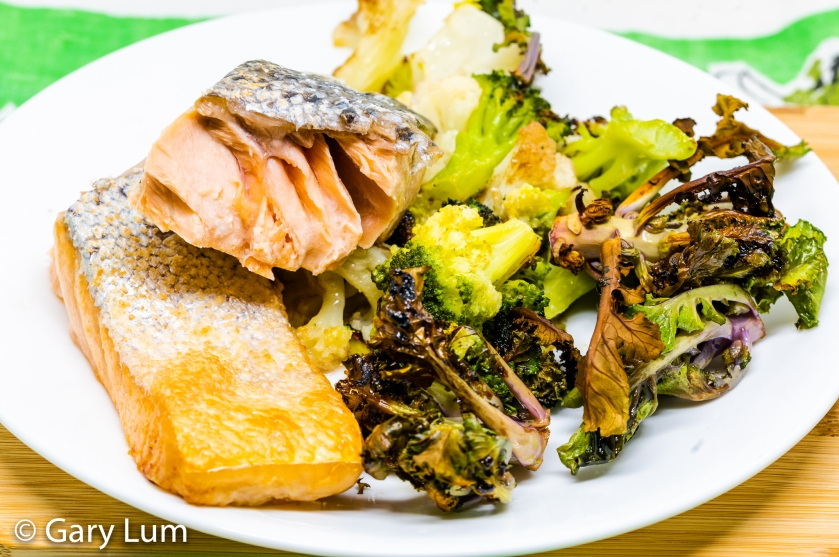Oven-cooked salmon, cauliflower, broccoli and balsamic glaze seasoned kale sprouts.