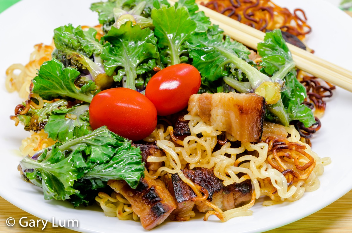 Pressure cooker hoisin black bean sauce pork belly with pan-fried Asian pasta and kale sprouts.