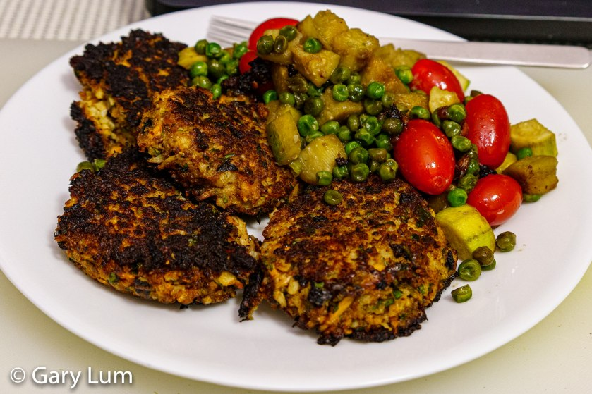 Tuna cauliflower cakes with jam-sweetened eggplant, zucchini, and peas.