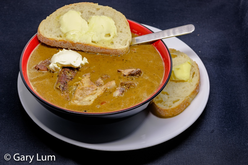 Irish stew cum soup with bread, butter, and sour cream.