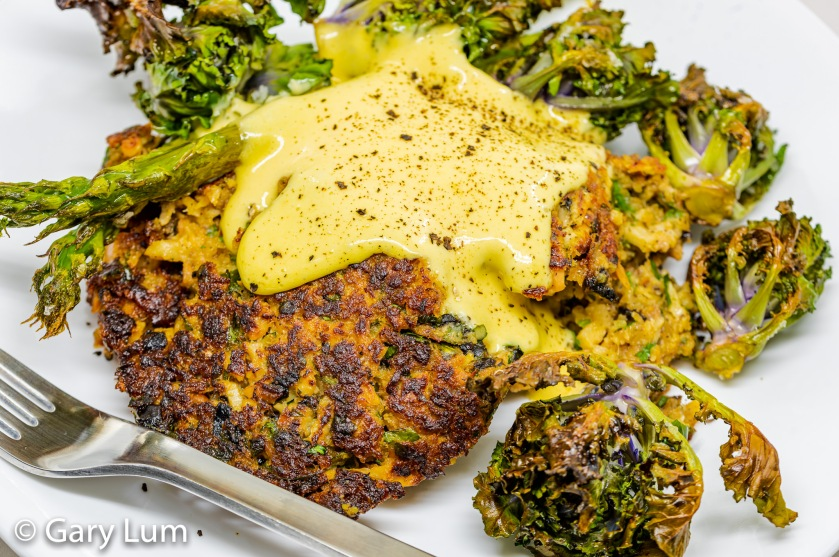Leftover tuna cakes and hollandaise sauce with oven-cooked asparagus and kale sprouts.