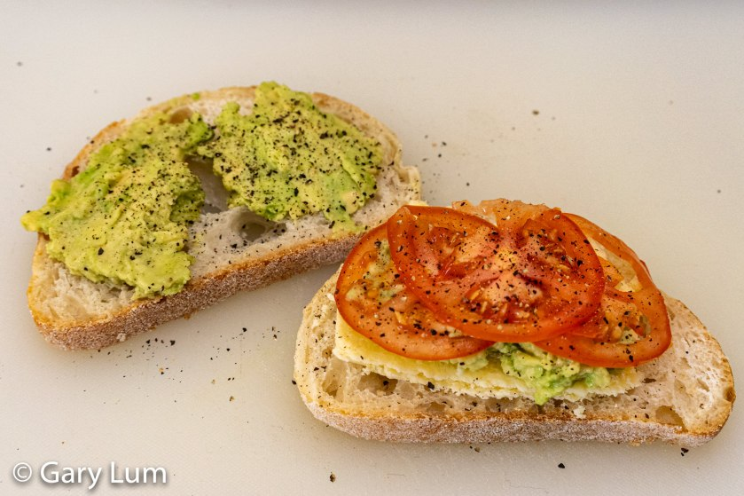 Italian bread with Mersey Valley pickled onion cheese, sliced tomato, and smashed avocado