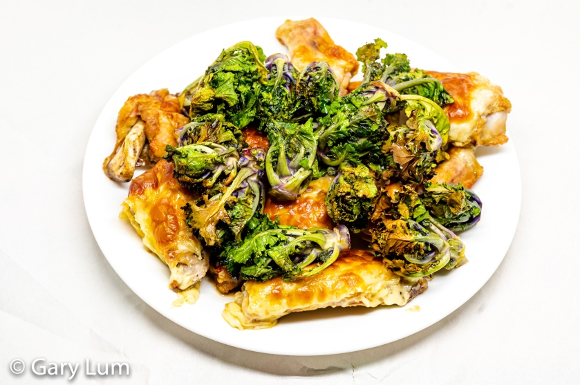 Mozzarella crusted chicken wings and kale sprouts.
