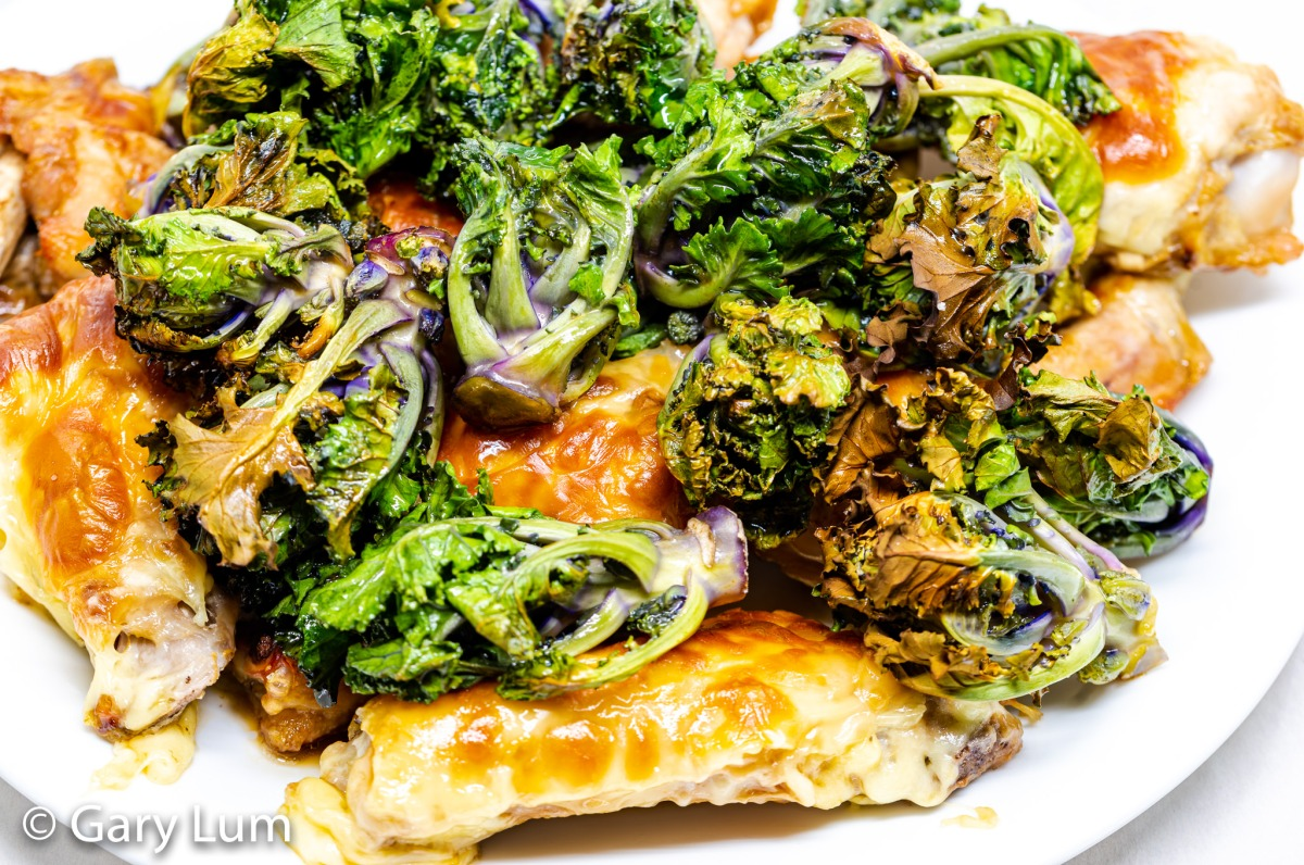 Mozzarella crusted chicken wings and kale sprouts